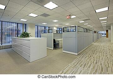 Área de oficina con cubículos