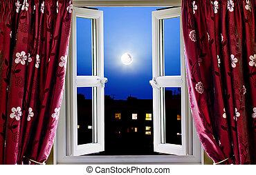 Abre la ventana a los edificios de noche