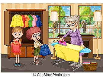 Abuela planchando ropa para niños