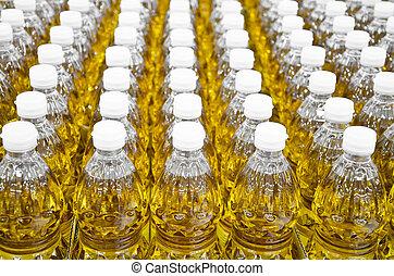 Aceite de botella vendiendo en un mercado