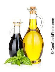 Aceite de oliva y botellas de vinagre con albahaca