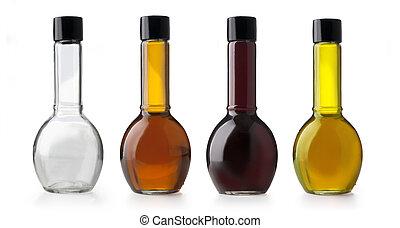 Aceite de oliva y botellas de vinagre.