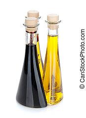 Aceite de oliva y botellas de vinagre