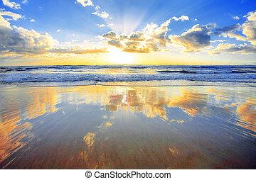 Al amanecer sobre el océano