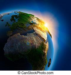 Al amanecer sobre la Tierra en el espacio exterior