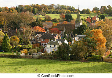 Aldea inglesa con iglesia en otoño