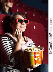 Alegre mujer en el cine