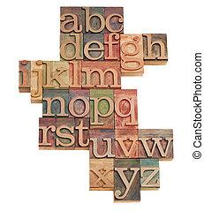 Alfabeto abstracto en pilas de madera