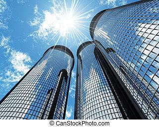 Altas rascacielos modernos en un fondo del cielo azul y en parches solares de luz