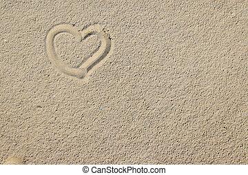 Arena y corazones