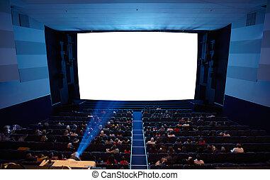 Auditorio de cine con luz de proyector.