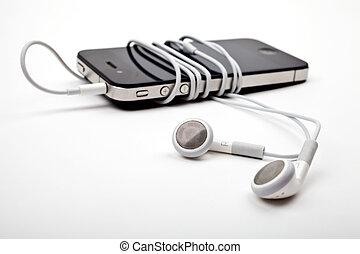 Auriculares y músico
