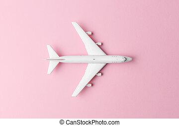 Avión blanco con antecedentes rosas