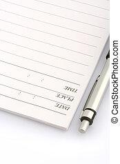 Ballpen y cuaderno
