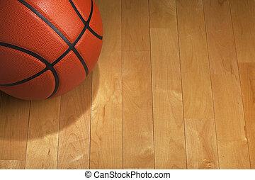 Baloncesto con iluminación en el suelo del gimnasio