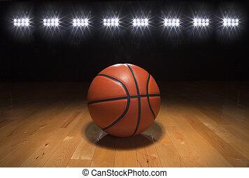 Baloncesto en el suelo de madera bajo luces brillantes