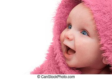 Bebé con manta rosa