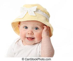 Bebé sonriente con sombrero