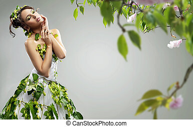Belleza joven usando un vestido ecologico