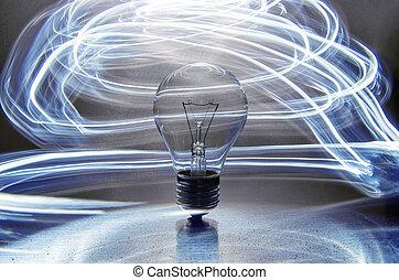 Bombilla. Electricidad. Luces alrededor de la bombilla.
