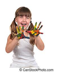 Bonita niña feliz pintando con sus manos