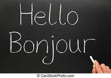 Bonjour, hola en francés escrito en una pizarra.