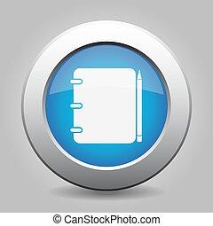 Botón de metal azul, libreta con lápiz