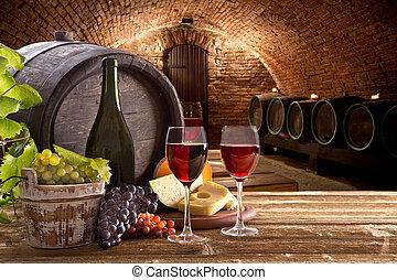 Botella de vino y vasos en mesa de madera