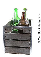 Botellas de vidrio en caja de madera