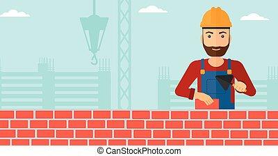 Bricklayer con espátula y ladrillo.