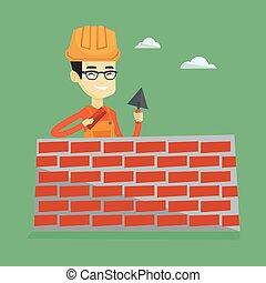 Bricklayer trabajando con espátula y ladrillo.