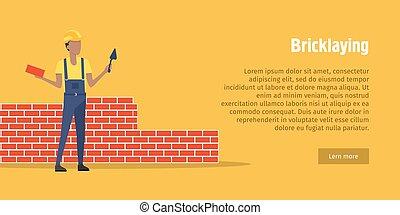 Bricklaying. Trabajador con espátula, ladrillo en manos