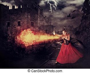 Bruja en el castillo medieval lanzaba magia, bola de fuego