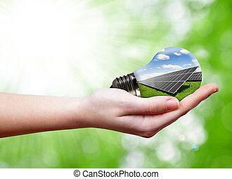 Bulbo con panel solar en mano