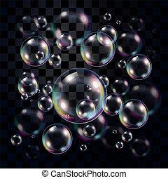 Burbujas de jabón transparentes y multicolores en la oscuridad
