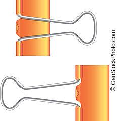 Cápsulas. Un clip de papel naranja. Un icono real.