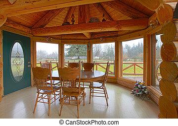 Cabaña de troncos en el comedor y la cocina