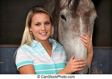 caballo, mujer, acariciando