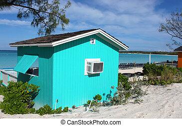 Cabana colorida en la playa tropical