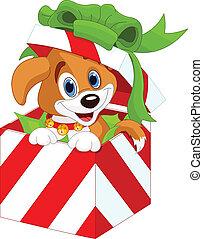 Cachorro en una caja de regalos de Navidad