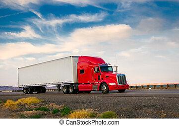 Camión rojo moviéndose en una carretera