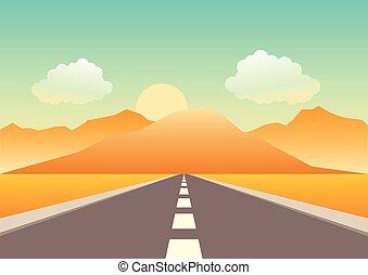 Camino vacío dirigiéndose a las montañas