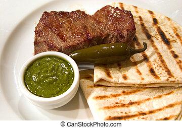 Carne asada con pan plano