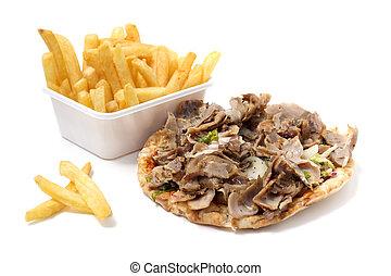 Carne asada en tortilla con papas fritas en blanco