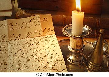 Carta vieja y vela
