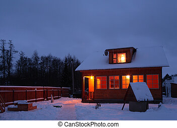 Casa de campo en la noche de invierno