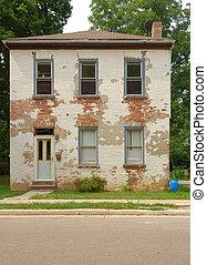 Casa de ladrillos de dos pisos