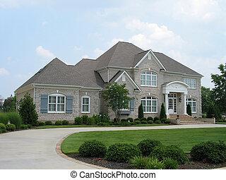 Casa de ladrillos gris