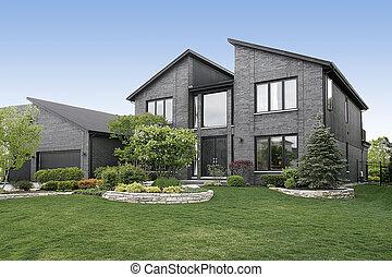 Casa de ladrillos grises moderna