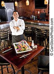 Chef japonés de restaurantes presentando sushi platter